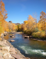 Fall Tree Colors along Creek with Mesa in Background
