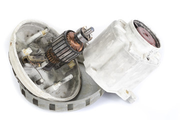 Old broken electric motor on white background
