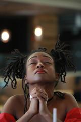 African girl offering prayers heartily