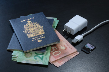 Canadian passports with Canadian dollars banknotes