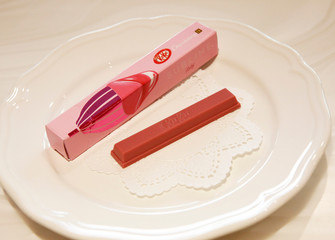 Nestle's KITKAT Chocolatory Sublime Ruby, made of pink 'Ruby' chocolate, is pictured with its package during a photo opportunity at KITKAT Chocolatory shop in Tokyo
