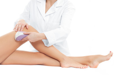 Beautician removing hair of woman's leg.  Laser epilation