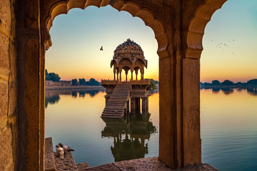 Wall Mural - Gadisar lake (Gadi Sagar) at Jaisalmer Rajasthan with ancient temples and archaeological ruins at sunrise