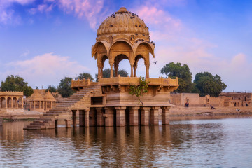 Wall Mural - Gadi Sagar (Gadisar) lake Jaisalmer Rajasthan with ancient architecture at sunset