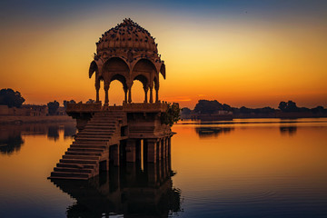 Wall Mural - Gadi Sagar (Gadisar) lake Jaisalmer at dawn with ancient temples and architecture