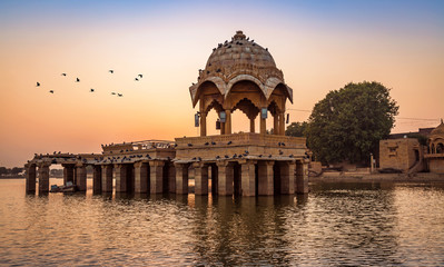 Wall Mural - Ancient temple at Gadi Sagar (Gadisar) lake Jaisalmer Rajasthan at sunset