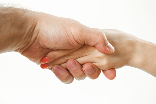 handshake of a man and a woman. hands without clothes.