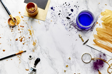 Paints and color splashes on artist's workplace. White background. Wall mural