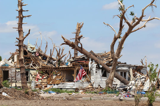 American Flag In The Yard Of An EF5 Tornado Distroyed Home IRepresents Defiance of Nature's Destruction