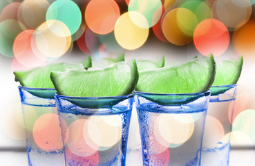 Cocktail with lime. Alcoholic beverage. tequila. A refreshing tonic.