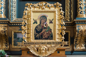 Picture  of Mary Our Lady with Baby Jesus in a richly decorated golden frame