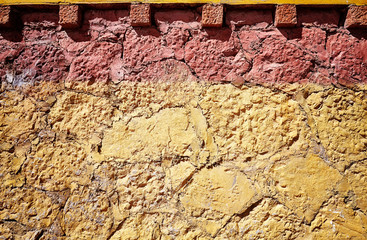 Old cracked clay stone wall background or texture.