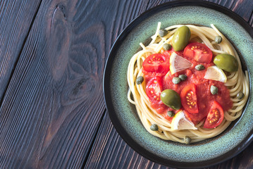 Pasta with tomato sauce, olives and capers