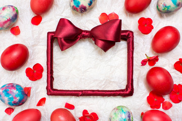 Empty red frame and painted Easter eggs