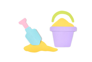 Sand bucket and shovel paper cut on white background - isolated