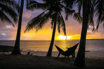 Man in Hammock on Sunset Paradise Beach - Siargao, Philippines