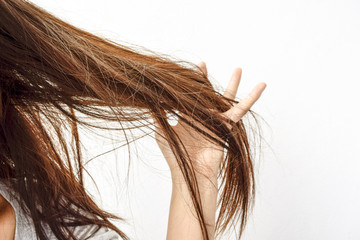Combing with brush and pulls long hair. Daily preparation for looking nice, Long Disheveled Hair,Holding Messy Unbrushed Dry Hair In Hands. Hair Damage, Health And Beauty Concept.