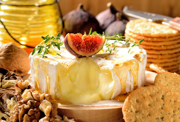 Camembert oven baked served with honey, walnuts and fresh figs.