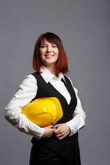 Image of woman builder in yellow helmet