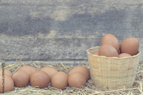 Good Quality Chicken Eggs In Rattan Basket On The Straw Nest