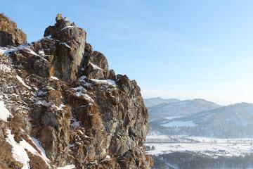 Top of the rock Devil's finger near Katun  River in the winter, Altai, Russia