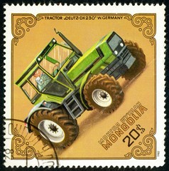 Ukraine - circa 2018: A postage stamp printed in Mongolia show Tractor Deutz-DX-230, Germany, Circa 1982