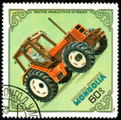 Ukraine - circa 2018: A postage stamp printed in Mongolia show Tractor Renault TX-145-14, France. Circa 1982.