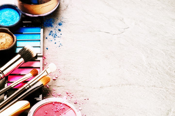 Various makeup products on dark background. Beauty and fashion concept