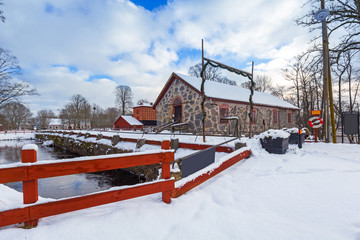 Winter scenery with river mill in Sweden
