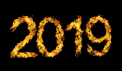 Number 2019 written by flames of fire isolated on black background. New Year concept.