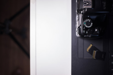 Digital camera with  memory card on laptop preparing to transfer photos