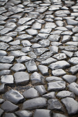 paving - background of old cobblestone pavement close-up.