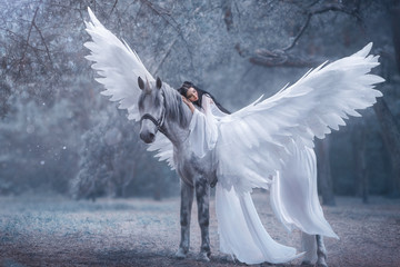 Fotorolgordijn Bestsellers Kids Beautiful, young elf, walking with a unicorn. She is wearing an incredible light, white dress. The girl lies on the horse. Sleeping Beauty. Artistic Photography