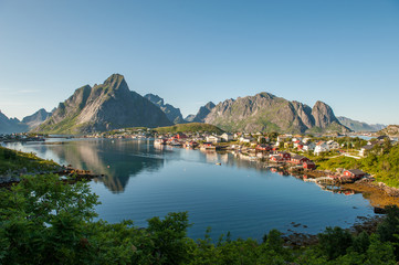 Reine at Lofoten islands in northern Norway on a sunny summer evening. Reine is a picturesque fishing village and a popular travel destination.