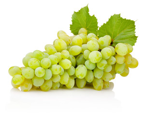 Fresh bunch of green grapes with leaves isolated on white background