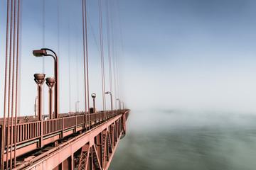 Fog over San Francisco. Part of the famous Golden Gate Bridge. The ocean coast near San Francisco, California.