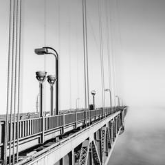 Fog over  Golden Gate Bridge. San Francisco. Part of the famous Golden Gate Bridge. The ocean coast near San Francisco, California. Black and white.