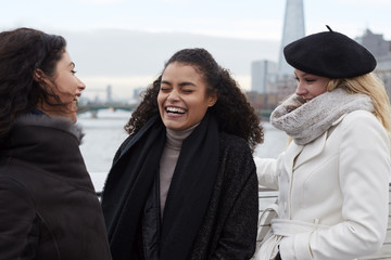 Group Of Young Female Friends Visiting London In Winter