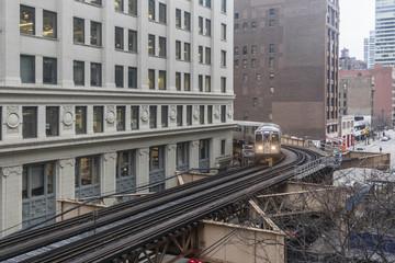 A subway train starting to round a corner