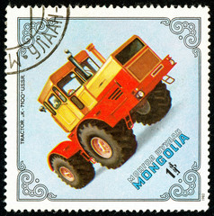 Ukraine - circa 2018: A postage stamp printed in Mongolia show Tractor K-7100, USSR. Series: Tractors. Circa 1982.