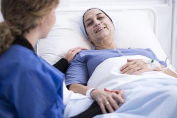 Woman enjoying visit of caregiver