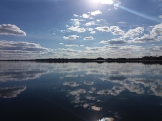 Mirror view of the lake Galadus in summer day. Poland - Lithuania border. North-eastern europe, sunny day, wild nature.