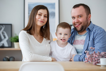Picture of happy parents with their son in room