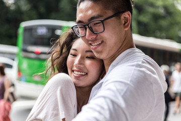 Young Asian Couple Embracing