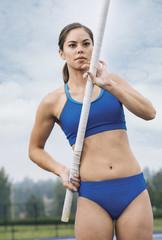 Female pole vaulter preparing for run up.
