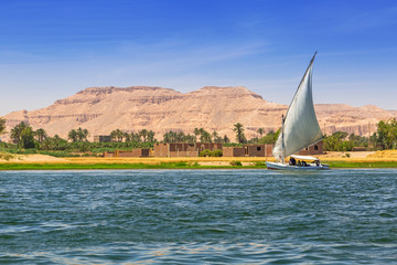 Fotobehang Egypte Falukas sailboat on the Nile river near Luxor, Egypt