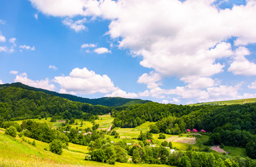 village in Carpathian mountains in summertime. lovely rural scenery under the blue sky with clouds