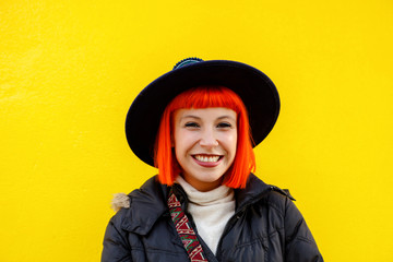 Attractive girl over a yellow wall