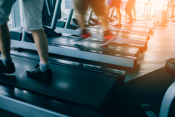 running people in fitness center on treadmill health concept