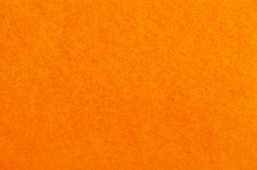 A close up of orange felt material background.